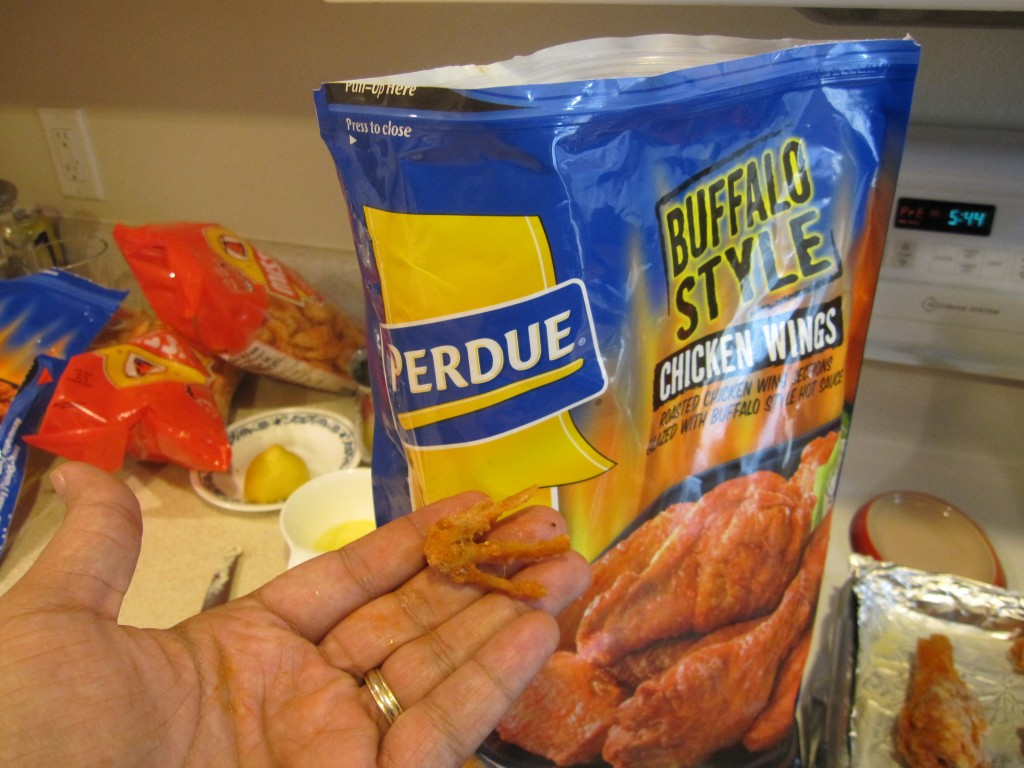 Photograph of Perdue brand buffalo wings with a chicken foot.