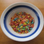 Photograph of a small amount of Fruity Pebbles in a typical bowl.