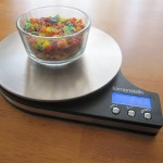 Photograph of Fruity Pebbles in a bowl on a food scale.