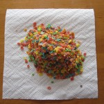 Photograph of fruity pebbles poured onto a paper towel.
